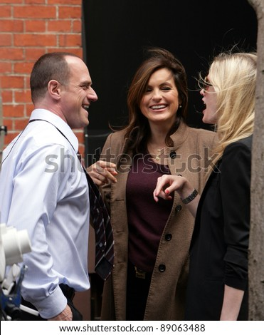 NYC - APRIL 15: Actress Mariska Hargitay, middle, with co-star Christopher Meloni, left, and former SVU star Stephanie March, right,  on the set of Law And Order: SVU in New York City on Friday, April 15, 2011. - stock photo