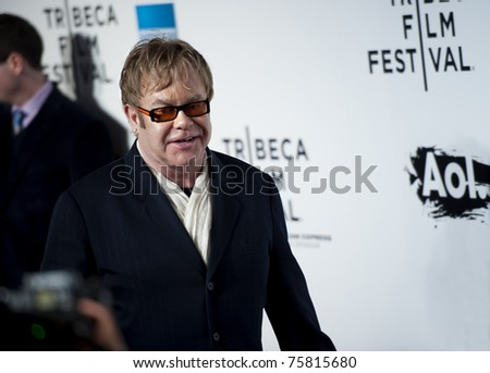 """NYC - APRIL 20 - Elton John walks past photographers at the opening night of the Tribeca Film Festival and world premier of """"The Union"""" on April 20, 2011 in New York City, NY - stock photo"""