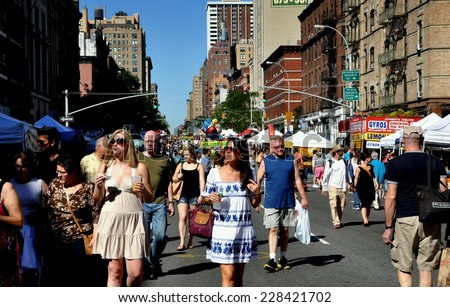 NYC - August 29, 2010:  Throngs of people strolling along Amsterdam Avenue in the West 80's during a summer street festival - stock photo