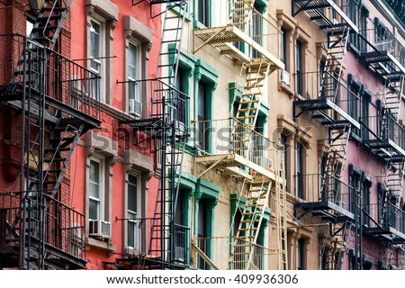NYC Block of Rainbow colored apartment buildings in Manhattan, New York City - stock photo