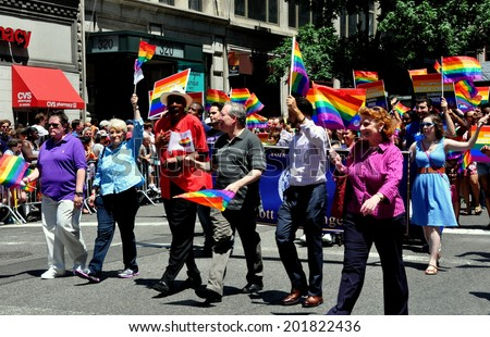 NYC - June 29, 2014:  New York City Comptroller Scott Stringer (center in gray shirt) with his group at the 2014 Gay Pride Parade on Fifth Avenue