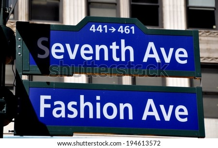 NYC - March 27. 2014 :  Street signs at the corner of Seventh Avenue and West 34th Street in the stretch known as Fashion Avenue