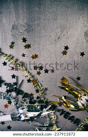 NYE Background: Confetti And Party Favors With Copyspace - stock photo