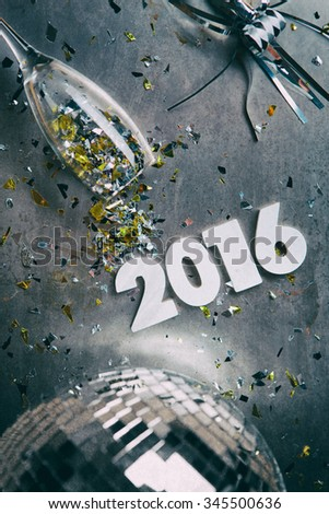 NYE: Grungy 2016 New Year Background With Spilled Confetti - stock photo