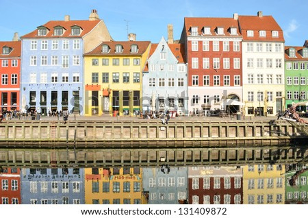 Nyhavn in Copenhagen Denmark - Famous tourist attraction - stock photo