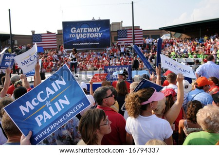 O'FALLON - AUGUST 31: Crowds hold signs at a McCain - Palin rally in O'Fallon near St. Louis, MO on August 31, 2008 - stock photo