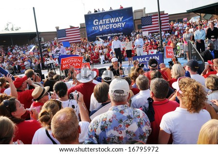 O'FALLON - AUGUST 31: Former Arkansas Governor Mike Huckabee (L) speaks at a McCain rally in O'Fallon near St. Louis, MO on August 31, 2008 - stock photo