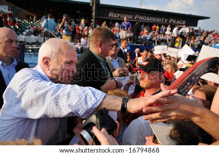 O'FALLON - AUGUST 31: Senator McCain shakes hands with supporters at rally in O'Fallon near St. Louis, MO on August 31, 2008 - stock photo