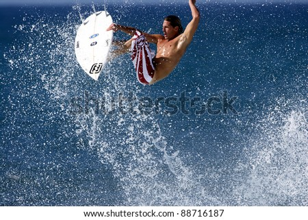 OAHU, HI - CIRCA 2005: Three time world champion surfer, Andy Irons, surfs at Off The Wall circa 2005 in Oahu, Hawaii. Andy Irons passed away unexpectedly on November 2, 2010. - stock photo