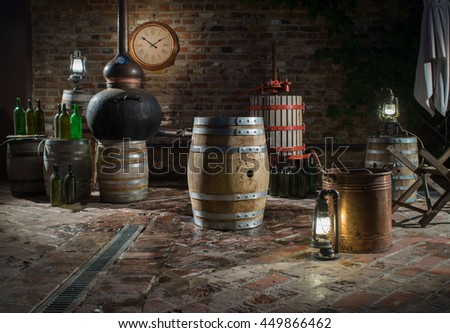 Oak barrels for 100 liters in the basement of a private distillery - stock photo