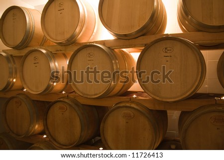 oak barrels in the old wine cellar used for wine storage - stock photo