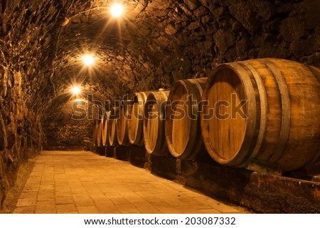 Oak barrels in the tunnel of old Tokaj winery cellar - stock photo