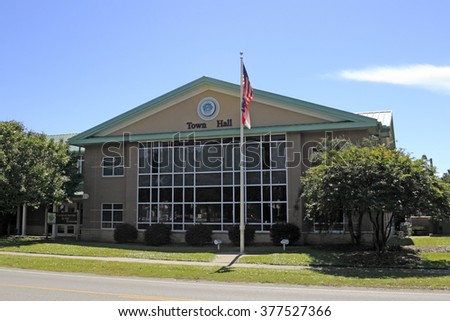 Oak Island, NC, USA - September 29, 2015: The front of Oak Island Town Hall on a sunny autumn day. Modern Oak Island Town Hall seen from the front on a sunny day in fall. - stock photo