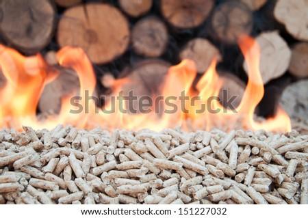 Oak Pellets in flames- stock photo - stock photo