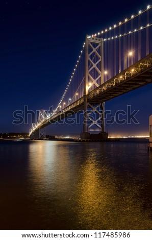 Oakland Bay Bridge at night, San Francisco, California - stock photo