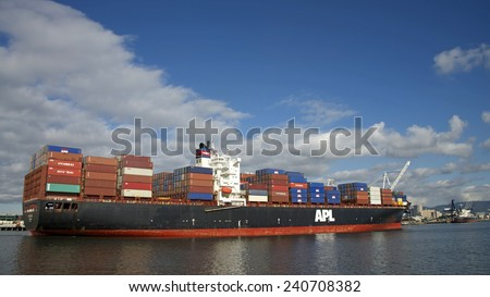OAKLAND, CA - DECEMBER 29, 2014: American President Lines (APL) Container ship APL HOLLAND entering the Inner Harbor at the Port of Oakland.