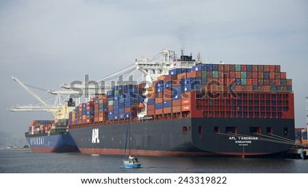 OAKLAND, CA - JANUARY 10, 2015: APL Cargo Ship YANGSHAN and  Hyundai Cargo Ship NEW YORK loading at the Port of Oakland, the fifth busiest port in the United States.