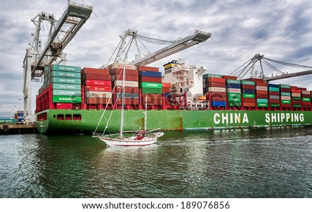 OAKLAND,CA-MAR 9, 2014: A loaded China Shipping cargo ship at the Port of Oakland, the fourth busiest container port in the USA and a major economic engine in the San Francisco Bay Area. - stock photo