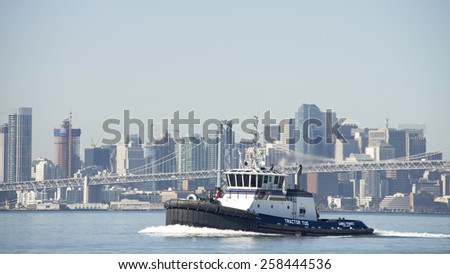 OAKLAND, CA - MARCH 05, 2015: Tractor Tugboat AHBRA FRANCO entering the Port of Oakland Middle Harbor. Tugs move vessels that should not move themselves, such as ships in a crowded harbor. - stock photo