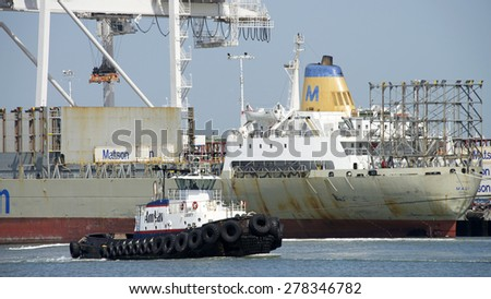 OAKLAND, CA - MAY 06, 2015: AmNav Tugboat LIBERTY at the Port of Oakland. American Navigation was a pioneer in developing tugboats with high horsepower engines in relatively small hulls. - stock photo