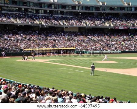 OAKLAND, CA - MAY 23: San Francisco Giants Vs. Oakland Athletics: A's Michael Wuertz steps forward to throw pitch to Aaron Rowand May 23 2010 at Coliseum Oakland California. - stock photo