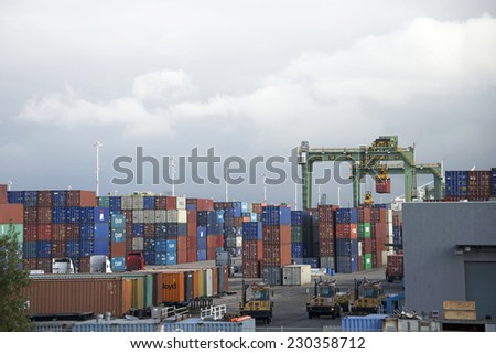 OAKLAND, CA - NOVEMBER 13, 2014: Port of Oakland, Constant activity is seen in and out of the terminal. as shipping containers unloaded from vessels in port are loaded on trains and trucks. - stock photo