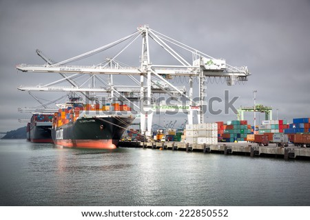 OAKLAND,CA-OCT 9, 2014: Loaded cargo ships at the Port of Oakland, the fourth busiest container port in the USA and a major economic engine in the San Francisco Bay Area. - stock photo