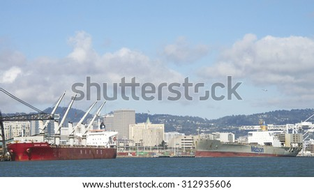 OAKLAND, CA - SEPTEMBER 02, 2015: Bulk Carrier NAVIOS HORIZON docked at the Port of Oakland loading scrap metal at Schnitzer Steel. City of Oakland in the background.