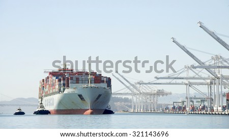 OAKLAND, CA - SEPTEMBER 21, 2015: Cargo Ship COSCO PACIFIC arriving at the Port of Oakland, the fifth busiest container port in the United States.