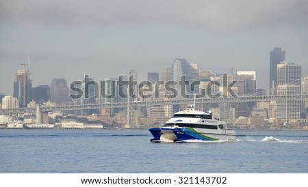 OAKLAND, CA - SEPTEMBER 18, 2015: The San Francisco Bay Ferry provides passenger service from Oakland and Alameda to the Ferry Building, Pier 41, Angel Island, and Oyster Point in San Francisco.