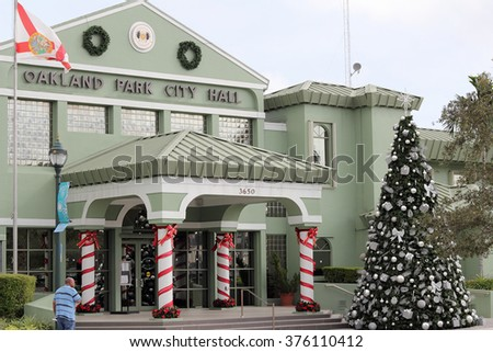 Oakland Park, FL, USA - December 23, 2015: Oakland Park City Hall decorated for Christmas trees and more. Town hall building decorated for the winter holiday season