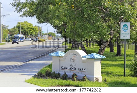 OAKLAND PARK, FLORIDA - MAY 11, 2013: Tree City USA sign next to a sign on the side of North Dixie Highway south of Oakland Park Boulevard welcoming people to the City of Oakland Park, Florida. - stock photo
