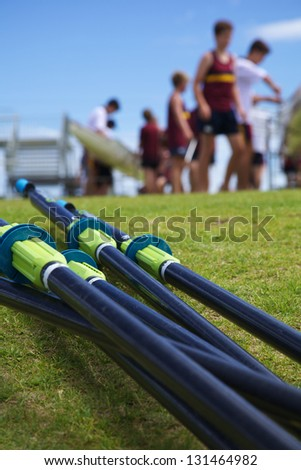 Oars With Background of a Busy Rowing Regatta - stock photo
