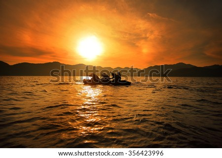 Oarsman sunrise at sea