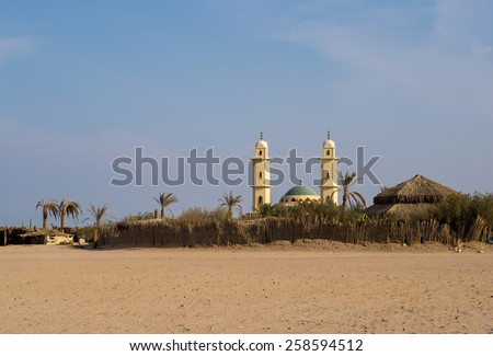 Oasis in Arabian desert. Visiting Bedouin in Egypt - African adventure in muslim cultural tradition. - stock photo