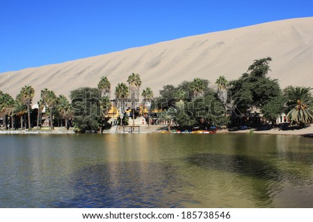 Oasis of Huacachina in Atacama desert in Peru - stock photo