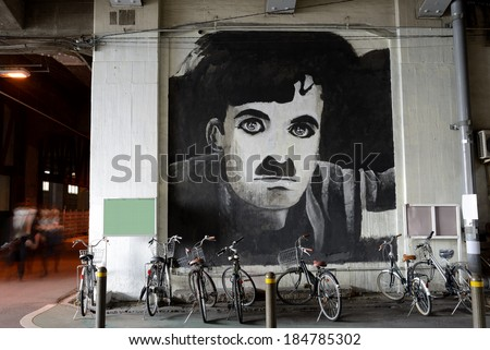 OASKA, JAPAN - Mar 28: Picture on an architecture of Charlie Chaplin, under elevated railway at Osaka City Nakatsu Station in Japan on Mar 28, 2014 - stock photo