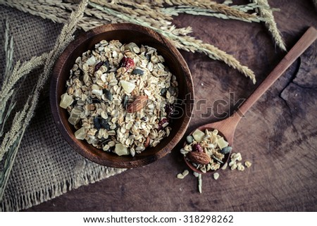 Oat and whole wheat grains flake in wooden bowl on wooden table, Vintage tone - stock photo