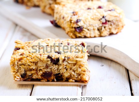Oat bars with cranberry, nuts and seeds - stock photo