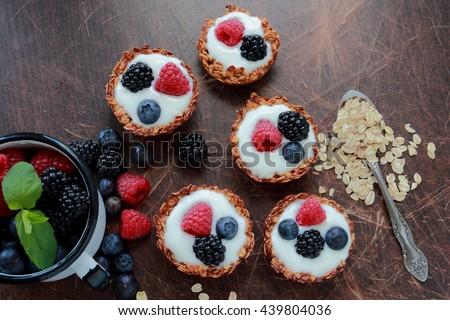 Oat cookies with fresh berries and light yogurt - stock photo