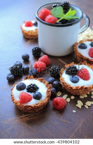 Oat cookies with light yogurt and fruits - stock photo