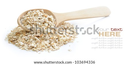 Oat flakes in wooden spoon on white background - stock photo