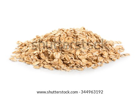 Oat flakes isolated on white background. Close up.