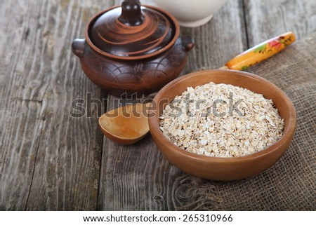 Oat flakes on old wooden table . - stock photo
