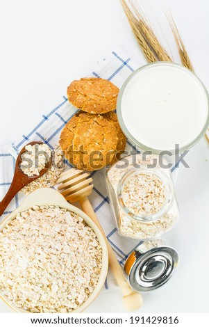 Oat flakes pile on the white background