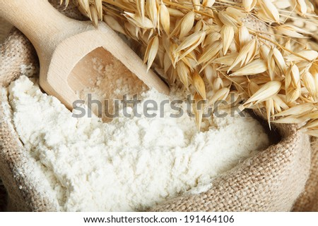 Oat flour in burlap bag  - stock photo