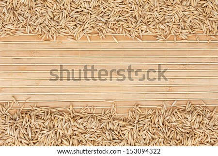 oat on a bamboo mat and place for text - stock photo