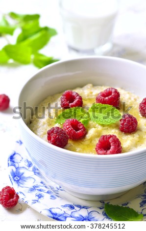 Oat porridge with raspberry and honey.Healthy breakfast.