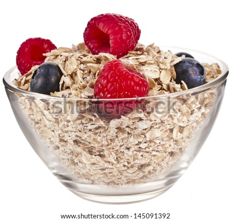 oat rolled flake in a bowl with fresh berries , diet concept isolated on white background - stock photo