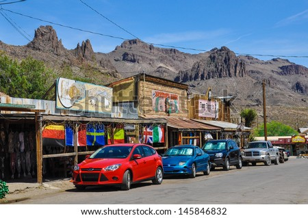 OATMAN, AZ -  MAY 14: The unique and nostalgic atmosphere in Oatman on the historic Route 66 on May 14, 2013 shows the contrast between modern cars and the antique architecture of the city. - stock photo